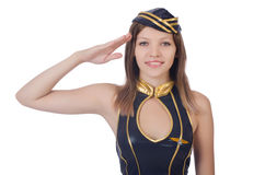 Young airhostess saluting. Isolated on white Royalty Free Stock Photo