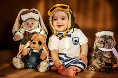 The young airman sitting with his soft toys Stock Photo