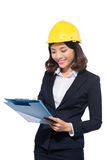 Young aisan beautiful architect working over white background.  royalty free stock photo