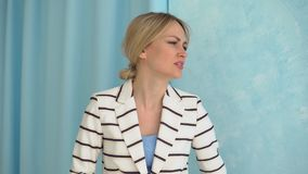 Young alarmed woman in a striped jacket. Close-up.  stock footage