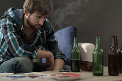 Young alcoholic. Picture of young alcoholic drinking beers alone Stock Photos