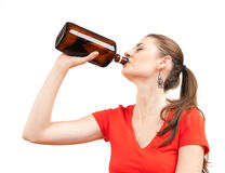 Young alcoholic woman drinking with bottle Stock Photo