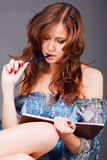 Young alluring girl poet in dress Royalty Free Stock Photos