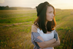 Young alone free sad woman hipster in fall field Royalty Free Stock Photo