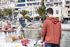 Young alone man on a port  in Kavala,Greece Royalty Free Stock Images