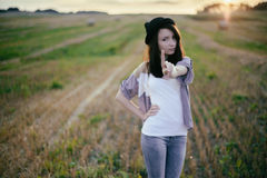 Young alonel free sad woman hipster in fall field Stock Photography