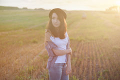 Young alonel free sad woman hipster in fall field Stock Photos