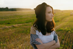 Young alonel free sad woman hipster in fall field Royalty Free Stock Photo
