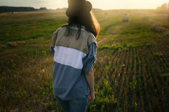 Young alonel free sad woman hipster in fall field Stock Photo
