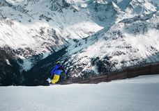 Young Alpine skier skiing downhill Royalty Free Stock Images