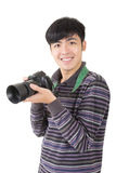 Young amateur photographer. Of Asian hold a camera, closeup portrait on white background royalty free stock photos
