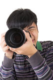 Young amateur photographer. Of Asian hold a camera, closeup portrait on white background stock images