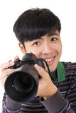 Young amateur photographer. Of Asian hold a camera, closeup portrait on white background royalty free stock images
