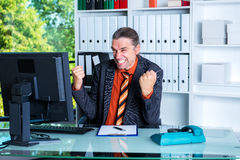 Young amazed business man at his desk. Amazed business man at his desk Stock Photos