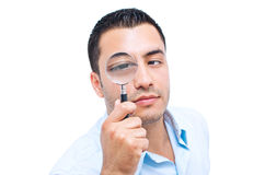 Young amazed man looking with magnifier Royalty Free Stock Photos