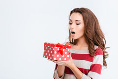 Young amazed woman holding gift box Royalty Free Stock Photos