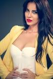 Young  amazing woman in yellow blazer Stock Photo