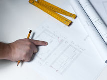 Young ambitious architect presenting the blueprint of a new hous Stock Photo