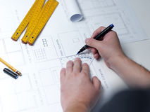 Young ambitious architect presenting the blueprint of a new hous Royalty Free Stock Photo
