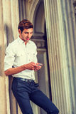 Young American Businessman texting outside in New York Royalty Free Stock Image