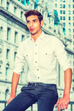 Young American Businessman thinking outside. Young Businessman. Wearing a white shirt, black pants, a young college student is sitting in the front of business Royalty Free Stock Photos