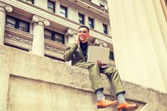 Young American Businessman traveling, working in New York. Happy American Businessman traveling, working in New York, wearing green suit, brown leather shoes Stock Photos