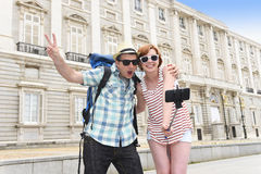 Young American couple enjoying Spain holiday trip taking selfie photo self portrait with mobile phone Royalty Free Stock Images