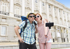 Young American couple enjoying Spain holiday trip taking selfie photo self portrait with mobile phone Stock Image