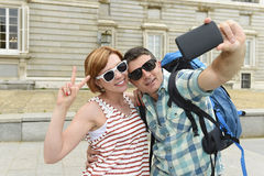 Young American couple enjoying Spain holiday trip taking selfie photo self portrait with mobile phone Royalty Free Stock Image