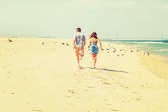 Young American Couple running, relaxing on the beach in New Jers Stock Image