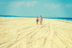 Young American Couple walking, relaxing on the beach in New Jers Royalty Free Stock Photography