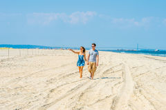 Young American Couple walking, relaxing on the beach in New Jers Stock Images