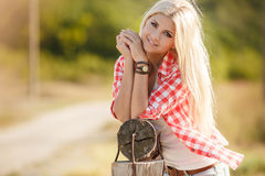 Young american cowgirl woman portrait outdoors. Royalty Free Stock Image
