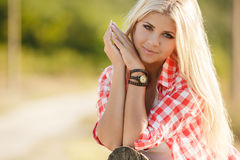 Young american cowgirl woman portrait outdoors. Royalty Free Stock Images