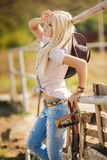 Young american cowgirl woman portrait outdoors. Royalty Free Stock Photography