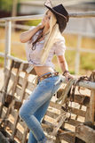 Young american cowgirl woman portrait outdoors. Stock Image