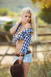 Young american cowgirl woman portrait outdoors. Stock Images