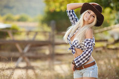 Young american cowgirl woman portrait outdoors. Stock Photography