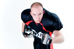 Young American football player. Isolated on white background Royalty Free Stock Photography