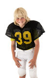 Young American football player. Young boy American football player with big smile Royalty Free Stock Photography