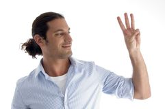Young american male with counting fingers Stock Photos