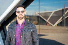 Young American man smiling happy with sunglasses portrait outdoor Stock Photo