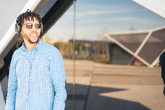 Young American man smiling happy with sunglasses portrait outdoor Royalty Free Stock Image