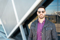 Young american man smiling happy with sunglasses portrait outdoor Stock Photos