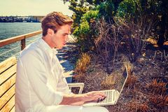 Young American Man working on laptop computer outside Royalty Free Stock Images