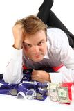 Young american manager and dollars. Isolated on the white background Stock Photo