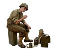 Young American soldier  light a cigarette. Young American soldier sitting on a jerrycan lights a cigarette Stock Photo