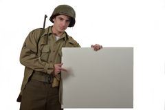 Young American soldier shows a sign Royalty Free Stock Photos