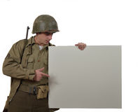 Young American soldier shows a sign Stock Photos