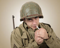 Young American soldier smoke cigarette, world war two Royalty Free Stock Photo